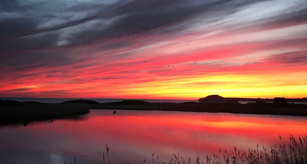 Rød solnedgang på Jorden